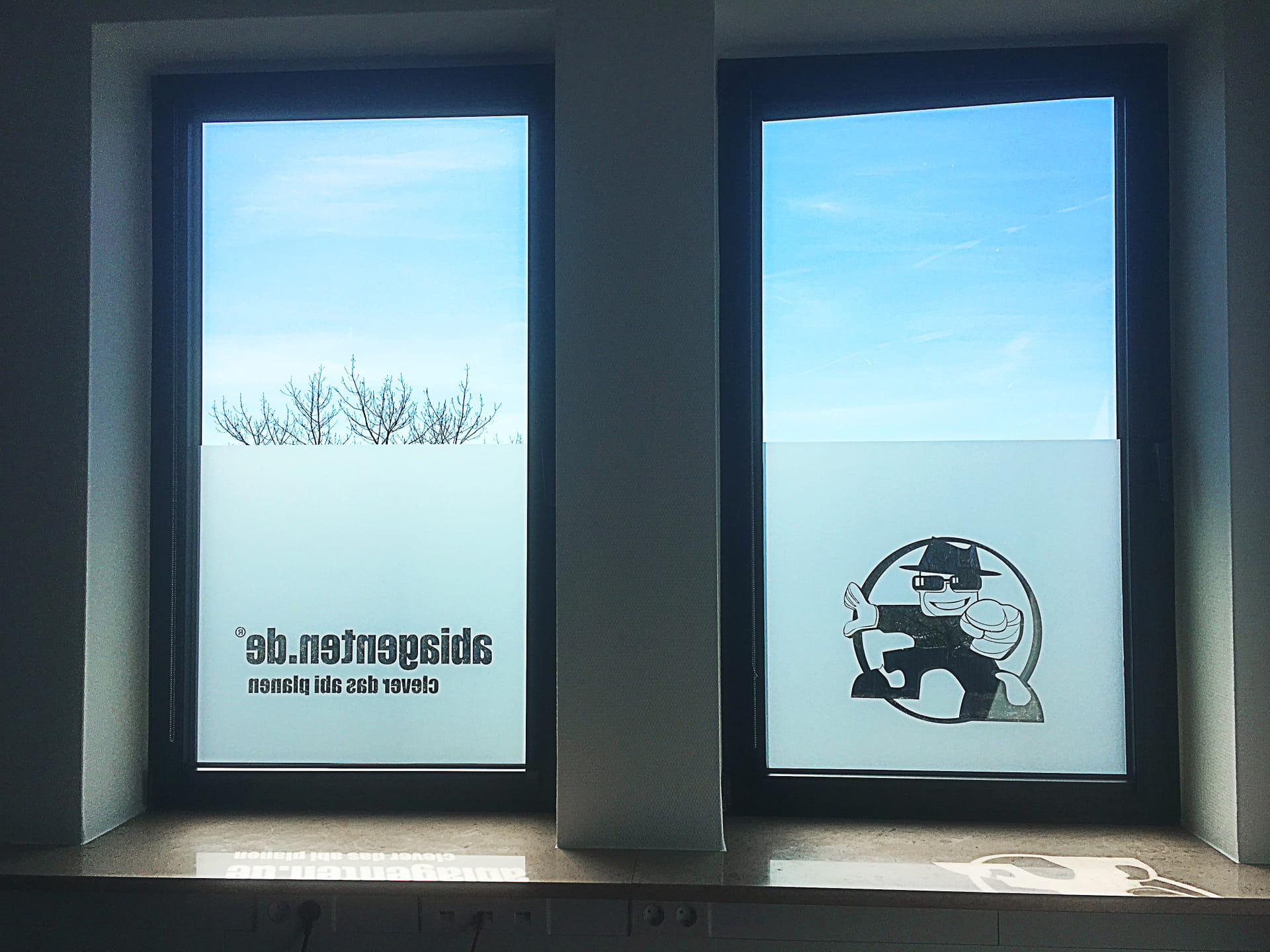 Window privacy protection with company logo professional foils from anplakt