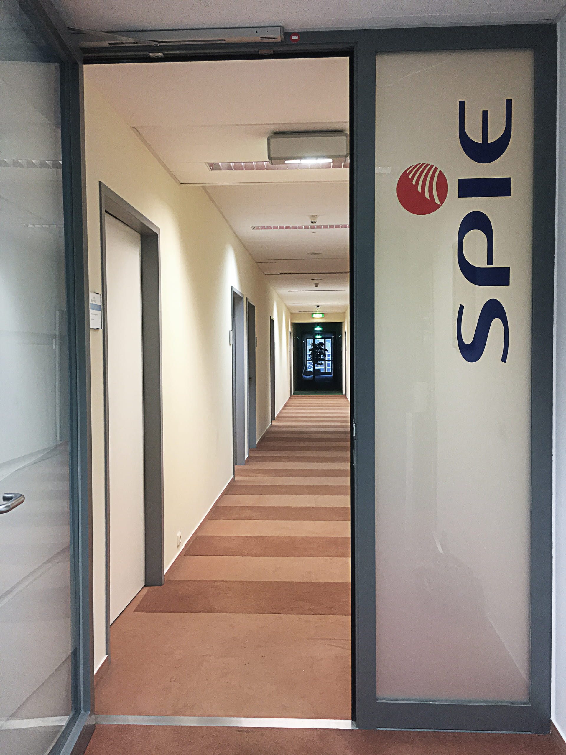Full-surface privacy protection with frosted glass foil and logo lettering for companies from anplakt