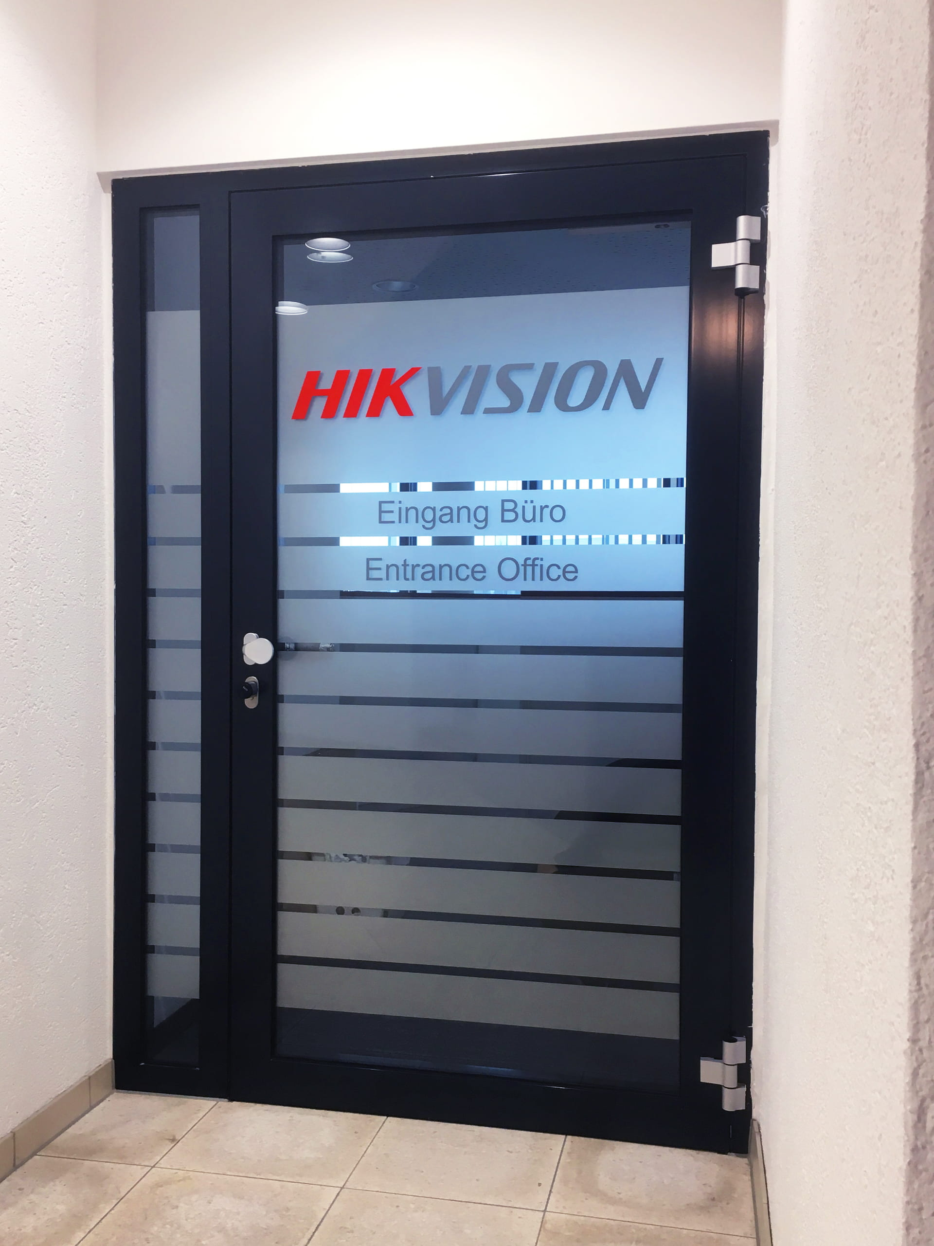 Entrance door with privacy strips and logo lettering from anplakt