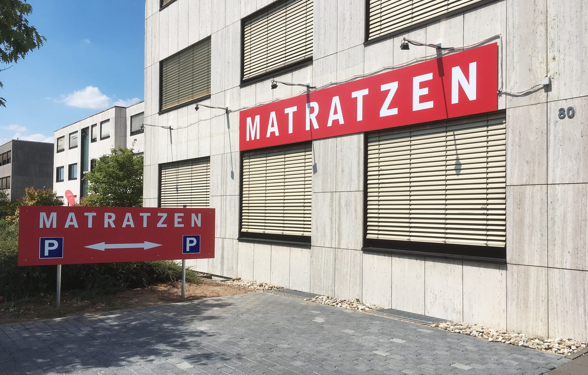 Outdoor advertising company sign and car park sign made of aluminium composite near Frankfurt